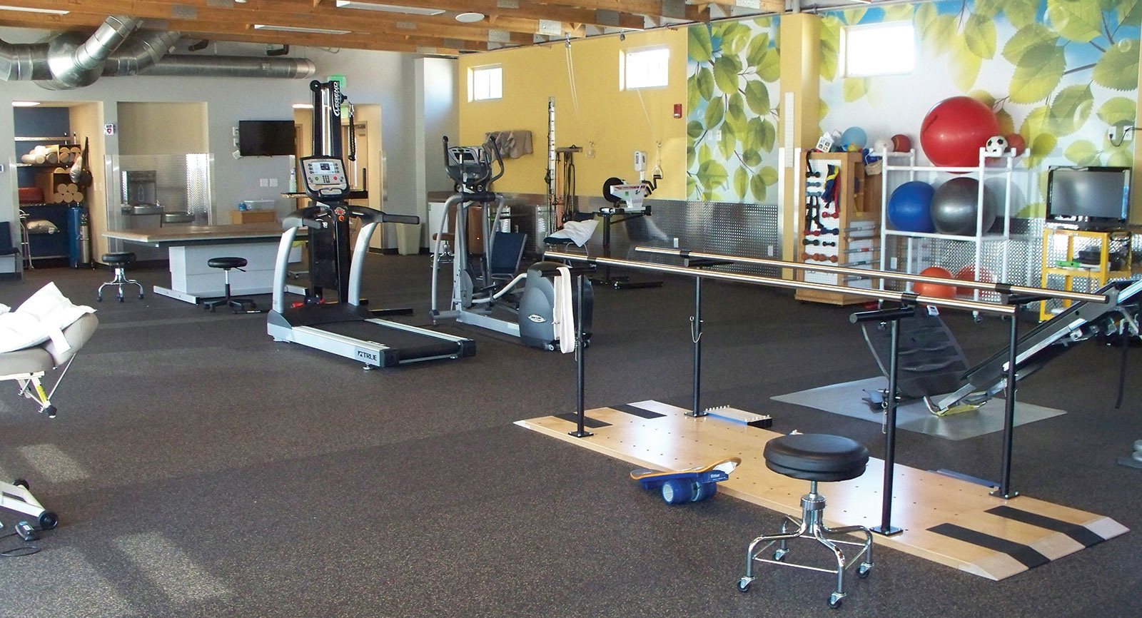 Prowers Medical Center Rehabilitation Center and Gym floor with a variety of equipment for patients to use